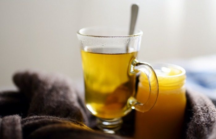 Image showing a cup of honey tea that is good for colds and sore throats. - Health Benefits Of Honey